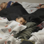 """AP photo used in Tampa Bay Times report on 12/22/14 shows """"Young detainees sleep in a holding cell on June 18, 2014, at a U.S. Customs and Border Protection processing facility in Brownsville,Texas."""""""