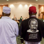 "Photo of Michael Brown Sr., right, at a City Council meeting in Ferguson, Mo., from a New York Times report, 2/10/16, ""Department of Justice Sues Ferguson, Which Reversed Course on Agreement"""