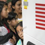 Immigrants from El Salvador and Guatemala who entered the country illegally board a bus after being released from a family detention center in San Antonio, Texas in 2015. (Eric Gay / Associated Press)