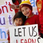 Los Angeles Unified School District students Alexandria Marek, 8, right, and Kerala Seth, 4, left, protested the district's cuts to the high-profile Mandarin Immersion Program at Venice's Broadway Elementary school in March. (Al Seib / Los Angeles Times)