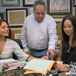 Wilfredo Allen, center, consults with Marlene Hasner and Camila Correal in his Miami office. Photo Credit: 10/30/16 Miami Herald Report