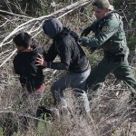 A U.S. Border Patrol agent detains juvenile undocumented immigrants near the U.S.-Mexico border in December 2015 at La Grulla, Texas. The number of unaccompanied minors crossing the border from Central America has surged in recent months. Photo Credit, San Diego Union Tribune report,  3/11/16